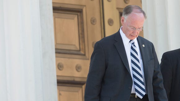 Governor Robert Bentley, who is expected to resign, leaves the Alabama Capitol Building on Monday, April 10, 2017, in Montgomery, Ala.