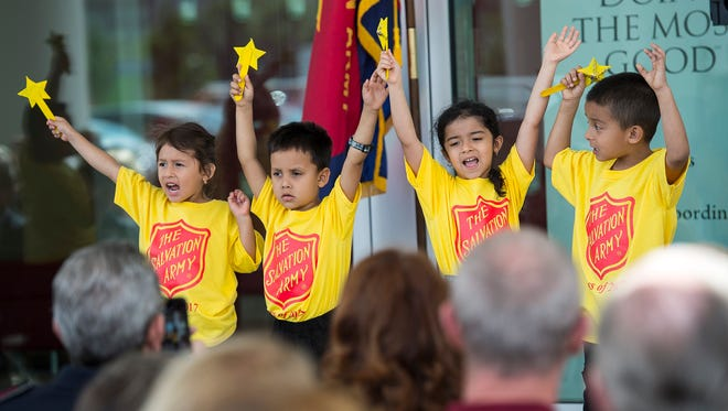"""Members of the Kidz Chorus sing """"This Little Light of Mine"""" during a ribbon-cutting and dedication for the new Fran Cohen Youth Center by the Salvation Army in Naples, Fla., on Monday, April 10, 2017."""