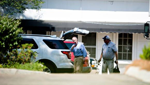 Former Governor Robert Bentley, left, prepares to move