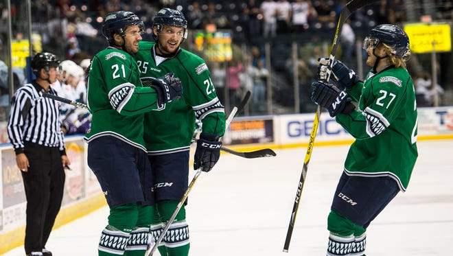 Florida Everblades players celebrate a goal during game 6 of the Kelly Cup Playoffs at Germain Arena in Fort Myers, Fla., on Tuesday, April 25, 2017.