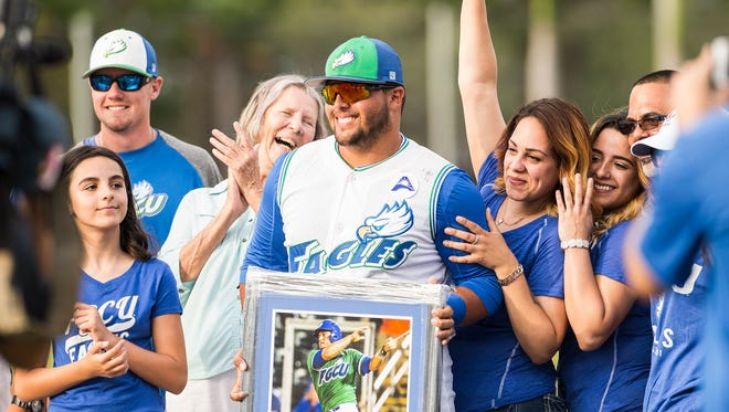 Florida Gulf Coast University's Nick Rivera poses with his family on Senior Day before a game in Fort Myers, Fla., on Saturday, May 13, 2017.