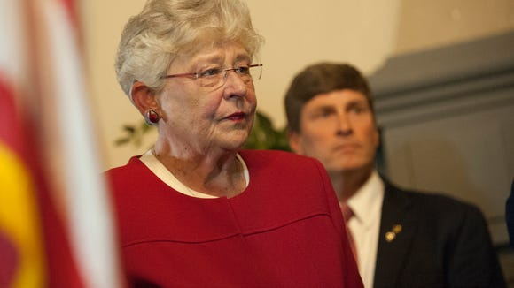 Gov. Kay Ivey prepares to sign military support bills on Tuesday, May 23, 2017, at Maxwell Air Force Base in Montgomery, Ala.