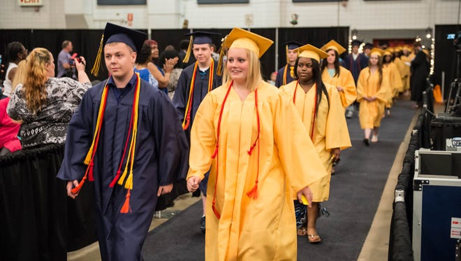 In this 2015 photo, graduating Battle Creek Central seniors walk down the aisle during their ceremony at Kellogg Arena.