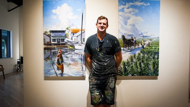 Artist Jarrett Stinchcomb poses next to some of his work at the Marco Island Historical Museum in Marco Island, Fla., on Wednesday, Nov. 2, 2016. The Marco Island native has been commissioned by Bonita Springs to paint a mural in that city's downtown.