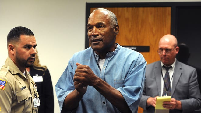 O.J. Simpson reacts after learning he was granted parole.