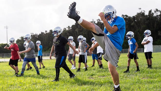 Football players run drills during the first practice for the new Bonita Springs High School in Estero, Fla., on Monday, July 31, 2017.