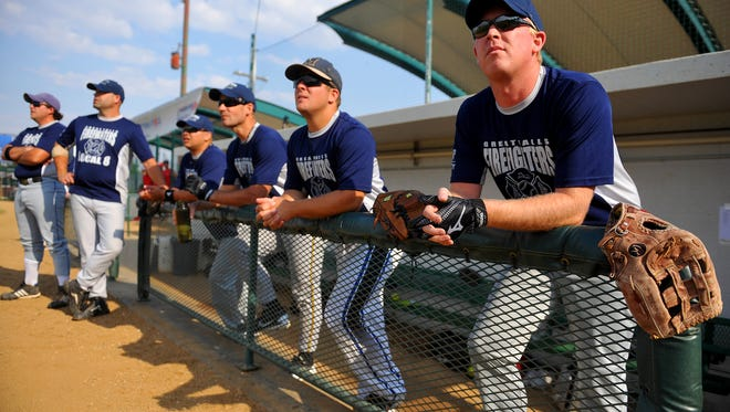 The Great Falls Fire Rescue team, the Hoses, look on during a previous Guns and Hoses Softball Game at Centene Stadium.