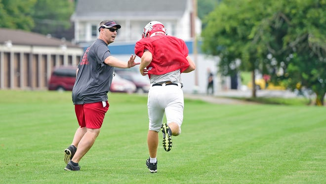 Dover High's football program will get a late boost from volunteer assistant coach Frank Gay, who will work with linebackers and running backs. He joined good friend and Dover head coach Wayne Snelbaker.