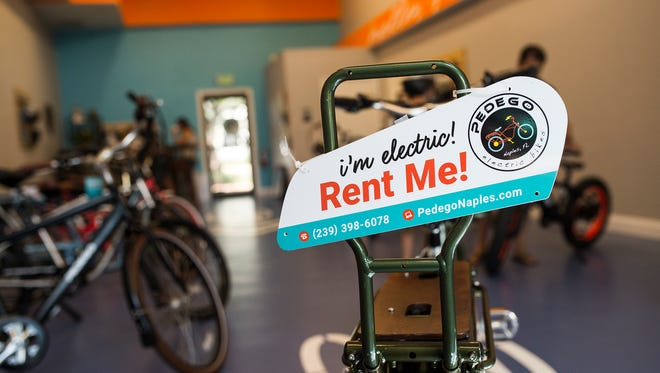 Bikes are on display inside a new Pedego shop in North Naples on Wednesday, Aug. 16, 2017