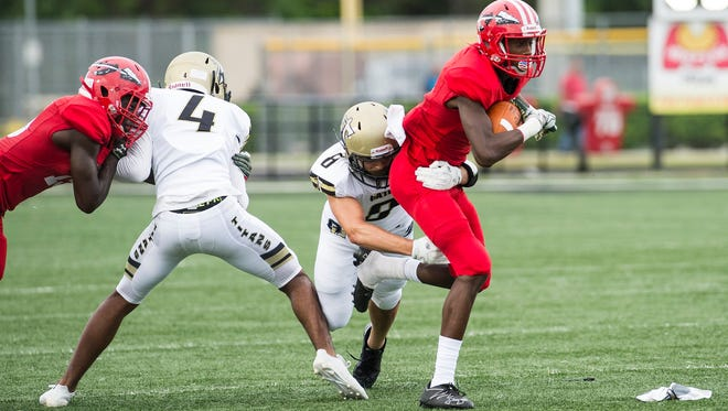 Immokalee High School's Eddie Joseph takes the ball during a game against Golden Gate High School in Golden Gate on Friday, August 25, 2017.