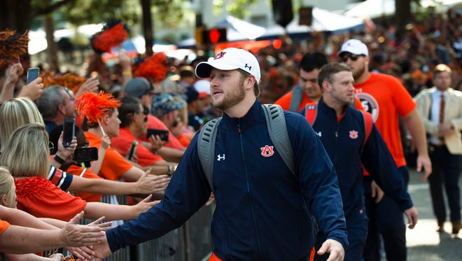 Auburn quarterback Sean White (13) greets fans in Tiger Walk before the Auburn vs. Georgia Southern football game on Saturday, Sept. 2, 2017, in Auburn, Ala.