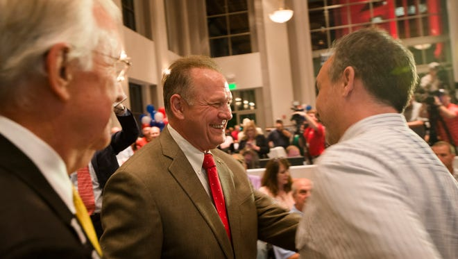 Roy Moore greets supporters during the Roy Moore for Senate election party on Tuesday, Sept. 26, 2017, in Montgomery, Ala.