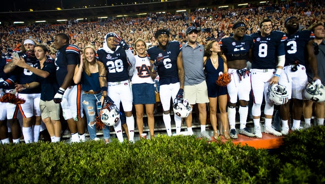 From Right, Auburn wide receiver Nate Craig-Myers (3), Auburn quarterback Jarrett Stidham (8), Auburn wide receiver Kyle Davis (11), Auburn defensive back Carlton Davis (6), and Auburn defensive back Tray Matthews (28) celebrate after the NCAA football game between Auburn and Mississippi State on Saturday, Sept. 30, 2017 in Auburn, Ala. Auburn defeated Mississippi State 49-10.