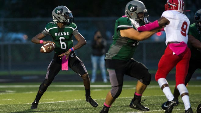 Palmetto Ridge High School's Jacquez Carter looks to pass during a game against Immokalee High School on Friday, October 6, 2017.