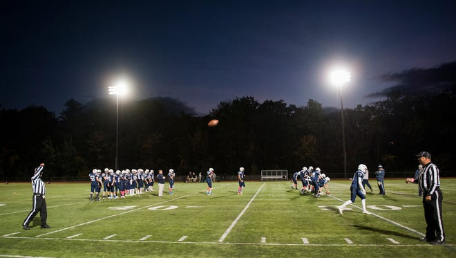 The referees warm up with a football during the high school football game between the Middlebury Tigers and the Burlington Seahorses at Buck Hard field last week.