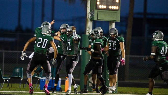 Palmetto Ridge High School celebrates after scoring a touchdown during a against Gulf Coast High School High school in Naples, Fla., on Friday, October 6, 2017.
