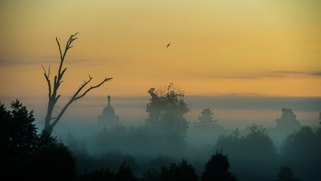 The Pennsylvania State Memorial at Gettysburg National Military Park is seen rising up from a bank of fog the morning of Aug. 4, 2016.
