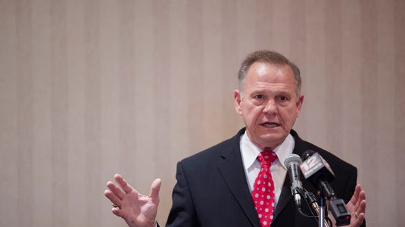 Republican Senate nominee Roy Moore speaks to the Alabama
