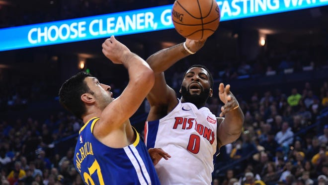 Pistons center Andre Drummond (0) passes the basketball against Warriors center Zaza Pachulia (27) during the first quarter on Sunday, Oct. 29, 2017, in Oakland, Calif.