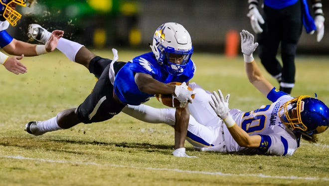 Eastside's Reggie Rodgers (5) stretches for a first down against Wren Friday night during the Eagles' 45-23 win in the first round of the Class AAAA football playoffs.