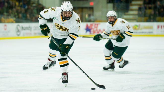 Vermont forward Max Kaufman (3) takes a shot during the men's hockey game between the Boston College Eagles and the Vermont Catamounts at Gutterson Field House on Friday night November 10, 2017 in Burlington.