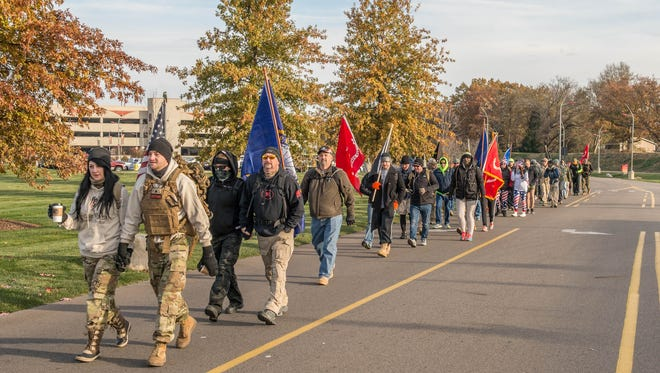Participants begin their march at FireKeepers Casino for the Veterans Helping Veterans Ruck March and Fundraiser Saturday morning.  Participants hiked to Dark Horse Brewing in Marshall.