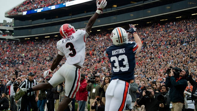 Georgia inside linebacker Roquan Smith (3) tips the ball away from Auburn wide receiver Will Hastings (33) during the NCAA football game between Auburn and Georgia on Saturday, Nov. 11, 2017, in Auburn, Ala. Albert Cesare