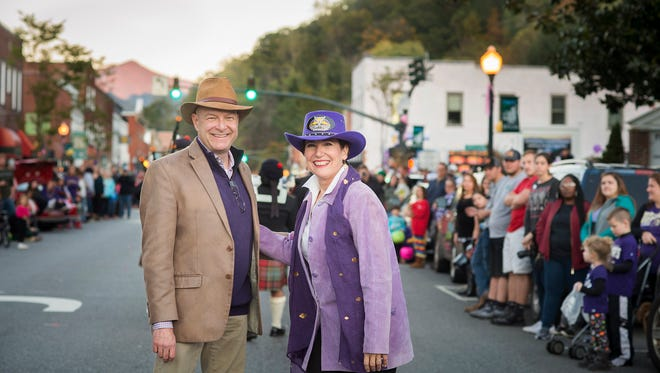 Western Carolina University Chancellor David Belcher, pictured with wife Susan at the 2017 Homecoming Parade in downtown Sylva, has announced plans to go on medical leave at the end of the year.