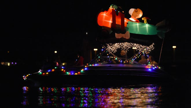 Christmas lights covered watercraft of all shapes and sizes Saturday, Dec. 16, 2017, during the annual Indian River County Christmas Boat Parade, which began just north of Barber Bridge and ended in front of the Vero Beach Municipal Marina.