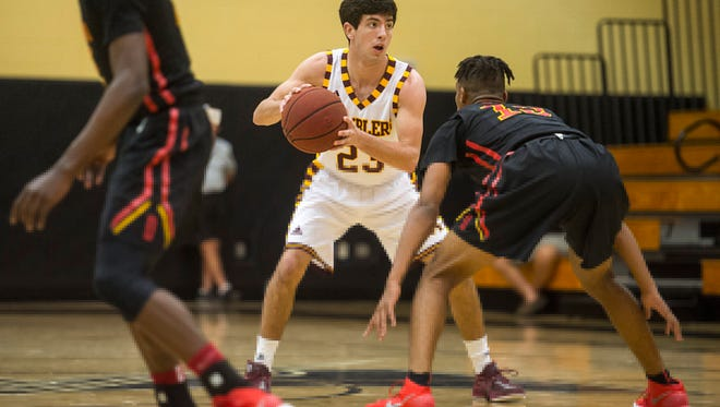 Loyola Academy's John Lynch brings the ball up the court during the Holiday Hoopfest championship game at Golden Gate High School on Saturday.