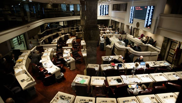 A bill is read in the Alabama House Chambers in this