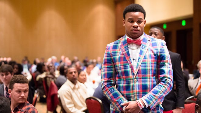 Maplesville athlete Nathaniel Watson stands to be honored during the Alabama Sports Writers Association Mr. Football award ceremony on Tuesday, Jan. 30, 2018, in Montgomery, Ala.