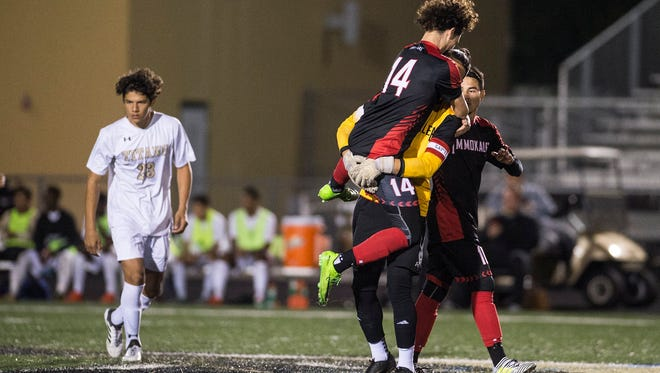 Immokalee High School celebrates a goal during the Class 3A-District 14 championship game at Golden Gate High School on Friday. The Indians beat the Titans, 2-1.