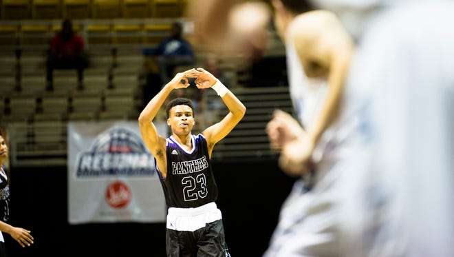 Prattville Christian's BJ Comer celebrates after hitting a 3-pointer during the AHSAA Regional Semifinal game on Monday, Feb. 19, 2018, at the Acadome in Montgomery, Ala.