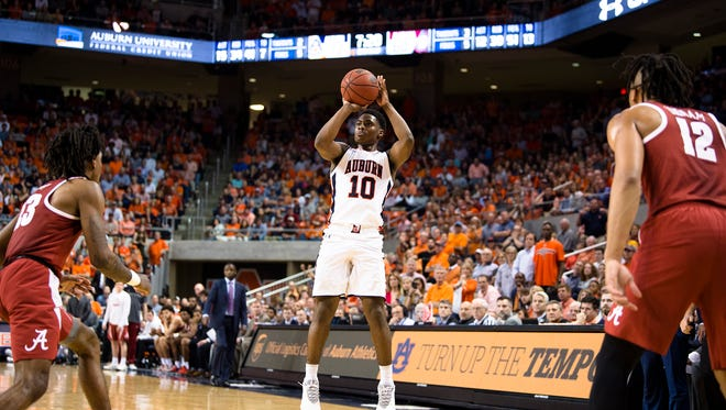 Auburn Tigers guard Davion Mitchell (10) hits a three point basket during the NCAA basketball game on Wednesday, Feb. 21, 2018, in Auburn, Ala.