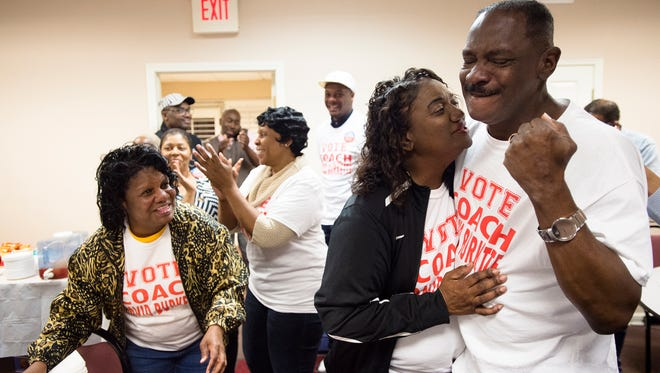 David Burkette is embraced by his wife, Linda, after finding out he had won the State Senate District 26 Democratic run off election on Tuesday, Feb. 27, 2018, in Montgomery, Ala.