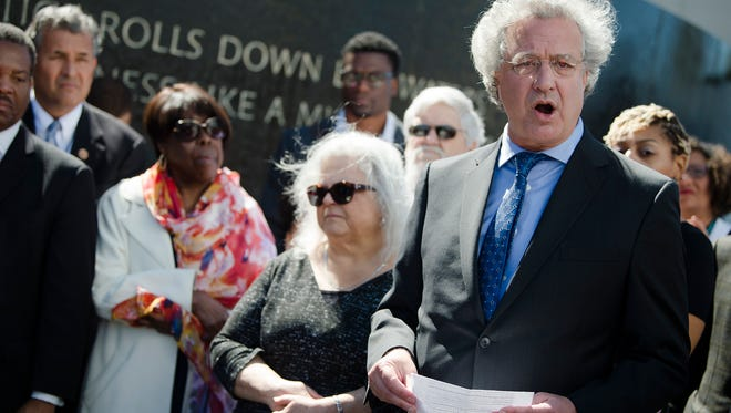 Richard Cohen, right, SPLC president, speaks during a wreath laying ceremony in Montgomery, Ala., on Saturday, March 3, 2018. Members of congress visited the site as part of a pilgrimage led by Congressman John Lewis.
