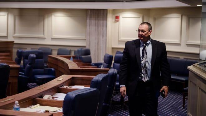 Sen. Paul Samford, R-Huntsville, walks the empty Senate Chambers during the Alabama Legislative session on Wednesday, March 28, 2018, in Montgomery, Ala.