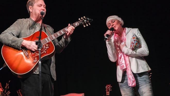 Steve Wariner and Anita Cochran perform a duet during a benefit concert for Cochran held last month in Nashville.