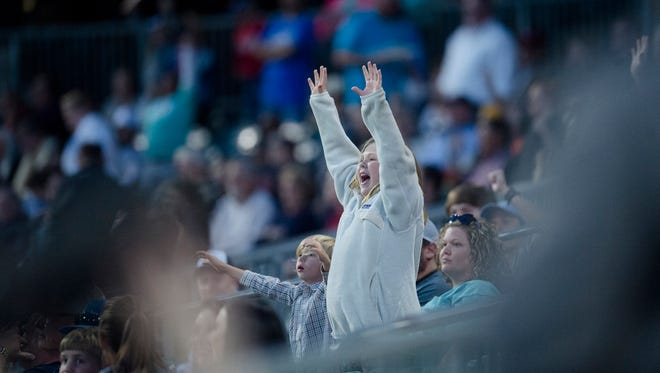 Fans cheer during the Montgomery Biscuits season home opener against the Biloxi Shuckers on Thursday, April 5, 2018.