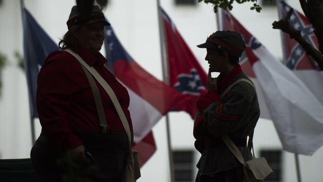 This 2017 photo shows people dressed in Confederate uniforms at the state capitol building in Montgomery as during a ceremony marking Confederate Memorial Day. Participants typically dress in Confederate costumes and pay tribute to ancestors who died fighting for the South.