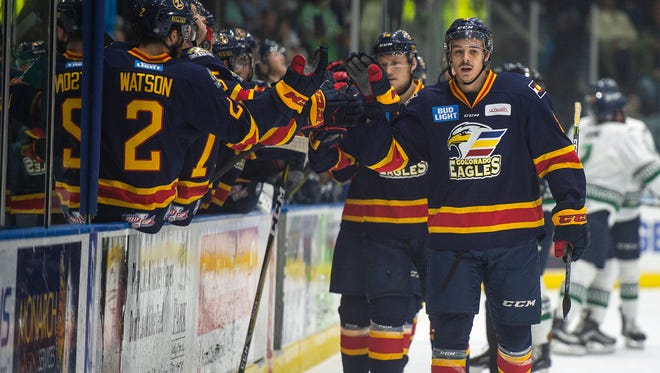Colorado Eagles players celebrate after scoring a goal layers during Game 3 of the Kelly Cup Finals at Germain Arena in Fort Myers, Fla., on Wednesday. The Eagles won 5-4 in overtime.