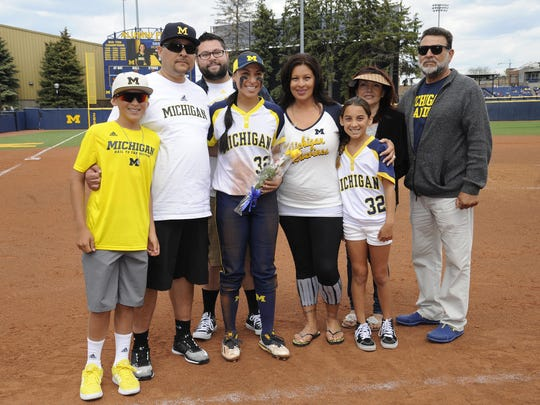 Michigan softball second baseman Sierra Romero (32), third from left, is surrounded by family members (left to right) brother Michael Romero Jr.,  age 12; father Michael Romero; uncle Mario Romero; mother Melissa Romero; sister Sophia Romero, age 10; stepmom Carolina; and grandfather Humberto Romero.