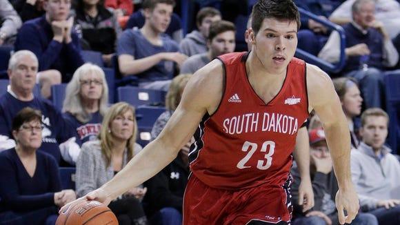 South Dakota forward Tyler Flack (23) drives to the