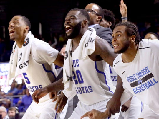 MTSU's Nick King (5), Giddy Potts (20) and TJ Massenburg (15) react from the bench in the final minutes of the game against UAB on Saturday.