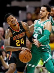 Atlanta Hawks' Kent Bazemore, left, is fouled by Boston Celtics' Shane Larkin in the second quarter of an NBA basketball game in Atlanta, Saturday, Nov. 18, 2017. (AP Photo/David Goldman)
