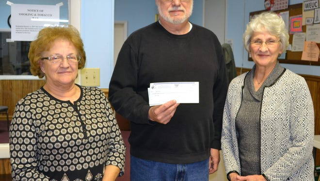 Durbin Council 1004 Knights of Columbus Grand Knight Matt Ciecorka (center) presents a check to Ben's Place officials Mary Jo  Adams (left) and Betty Brady (right) at the February 9 KC meeting.  The $600 plus dollars came from the annual KC Tootsie Roll drive last October.