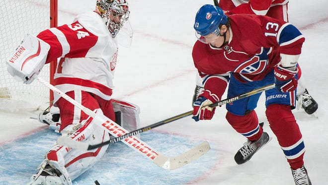 Detroit Red Wings goaltender Petr Mrazek, left, makes a save on the Montreal Canadiens' Alexander Semin on Oct. 17, 2015.