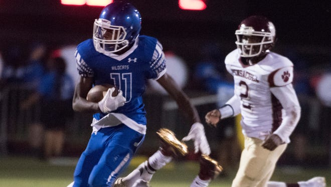 Washington High School receiver, Mystikal McGghee (No.11) runs after a catch against Pensacola High on Sept. 7, 2017.