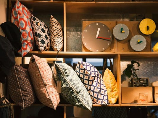Pillows and handmade clocks in an elegant shop